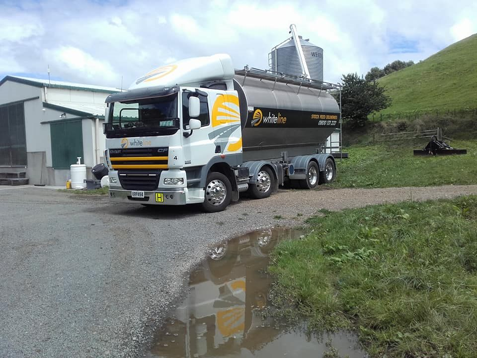 whiteline transport stock feed delivery truck on a farm